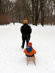 Families enjoying winter snow in Treptower Park in Berlin germany