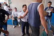 28 JULY 2004  -- TAPACHULA, CHIAPAS, MEXICO: Immigrants from Guatemala are returned to the Guatemalan side of the Mexico - Guatemala border near Tapachula, Mexico. They were caught trying to sneak into Mexico to get to the United States. Tapachula is center of the smuggling industry between Mexico and Guatemala. Consumer goods are smuggled south to Guatemala (to avoid paying Guatemalan import duties) and people are smuggled north into Mexico. Most of the people coming north are hoping to eventually get to the United States.  PHOTO BY JACK KURTZ