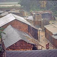 "Mondsoon rains drench a ""basti"" slum near Dhaka, Bangladesh."