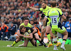 Exeter Chiefs Lachie Turner is tackled by Sale Sharks Luke James during the Aviva Premiership match at Sandy Park, Exeter.