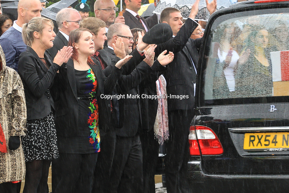 Sisters Rosie-Ann Stone (black dress, brunette) and Jennie Stone (Polkadot dress, blonde) pictured at the repatriation of their brother Gregg's body from Afghanistan in June 2012.<br /> Rosie-Ann has pleaded not guilty to a charge of causing death by careless driving at Bridlington Magistrates' Court. In tragic circumstances, the car crash in February resulted in the death of her sister, Jennie, who was driving another car along the same stretch of road and collided with a tree.  Thursday 07  June  2012.  Carterton, UK.<br /> Photo by: Mark Chappell/i-Images