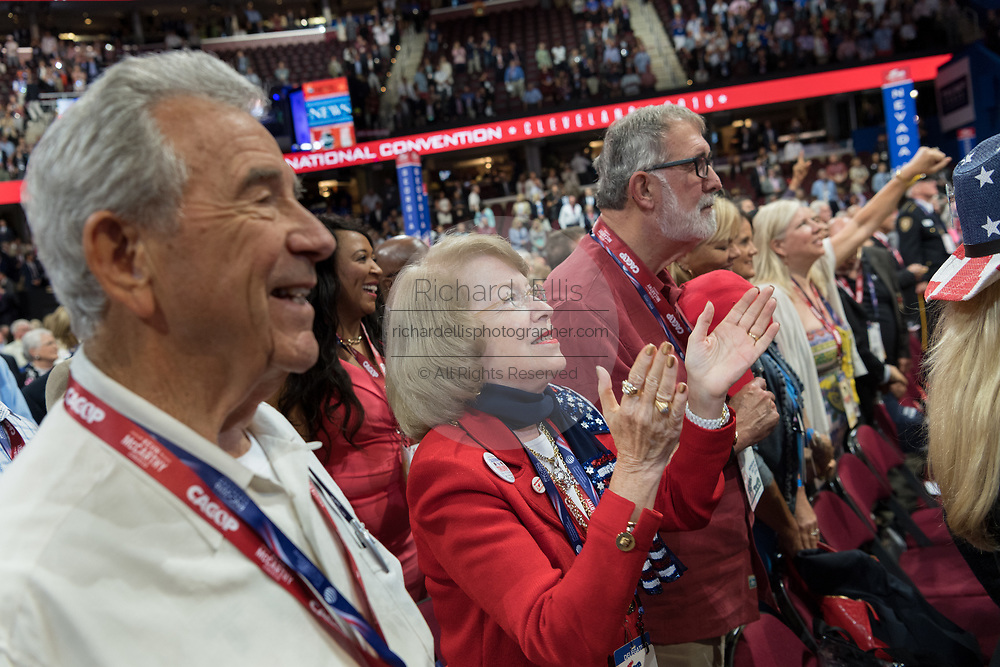A GOP delegate applaud during the Republican National Convention July 20, 2016 in Cleveland, Ohio.