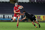 Jonathan Davies of the Scarlets goes past Kieron Fonotia of the Ospreys. Guinness Pro14 rugby match, Ospreys v Scarlets at the Liberty Stadium in Swansea, South Wales on Saturday 7th October 2017.<br /> pic by Andrew Orchard, Andrew Orchard sports photography.