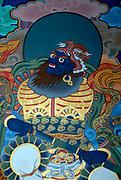 A painting in traditional Bhutanese style of a demon. It originates in Chinese and Tibetan buddhist art. Paro Dzong, Druk Yul,  Bhutan. 10 November 2007