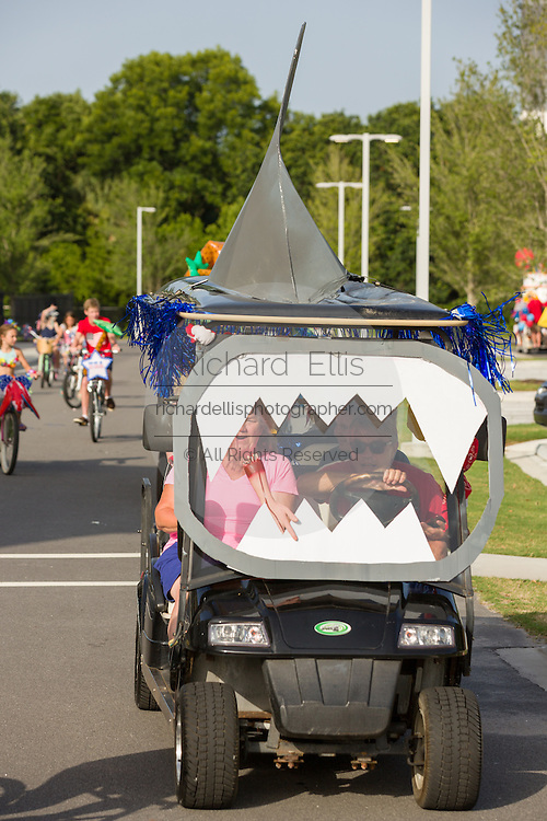 A golf carts decorated as a giant shark during the Sullivan's Island Independence Day parade July 4, 2015 in Sullivan's Island, South Carolina.