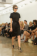 Black beaded dress. By Carmen Marc Valvo at the Spring 2013 Fashion Week show in New York.