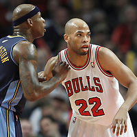 26 March 2012: Chicago Bulls forward Taj Gibson (22) defends on Denver Nuggets power forward Al Harrington (7) during the Denver Nuggets 108-91 victory over the Chicago Bulls at the United Center, Chicago, Illinois, USA. NOTE TO USER: User expressly acknowledges and agrees that, by downloading and or using this photograph, User is consenting to the terms and conditions of the Getty Images License Agreement. Mandatory Credit: 2012 NBAE (Photo by Chris Elise/NBAE via Getty Images)