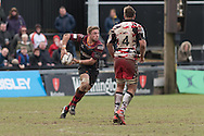 Lewis Evans of the Newport Gwent Dragons runs with ball in hand as Anton Bresler of Edinburgh rugby stands in his way. Guinness Pro12 rugby match, Newport Gwent Dragons v Edinburgh Rugby at Rodney Parade in Newport, South Wales on Sunday 27th March 2016.<br /> pic by  Simon Latham, Andrew Orchard sports photography.