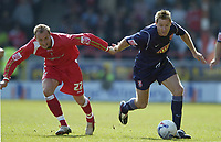 Photo: Jonathan Butler.<br /> Swindon Town v Walsall. Coca Cola League 2. 05/05/2007.<br /> Blair Sturrock of Swindon and Martin Butler of Walsall fight for the ball.