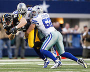 Pittsburgh Steelers tight end Heath Miller (83) is tackled by Dallas Cowboys inside linebacker Dan Connor (52) and cornerback Mike Jenkins (21) at Cowboys Stadium in Arlington, Texas, on December 16, 2012.  (Stan Olszewski/The Dallas Morning News)