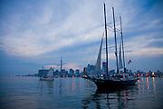 Boats in the harbor at Toronto, on Lake Ontario, Canada, at dusk.