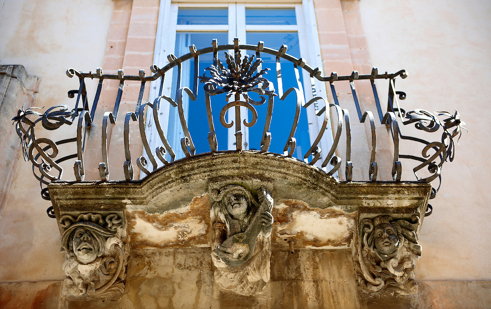 Palazzo La Rocca  balcony Baroque sculpted balcony corbels, Ragusa Ibla, Sicily .<br /> <br /> Visit our SICILY HISTORIC PLACES PHOTO COLLECTIONS for more   photos  to download or buy as prints https://funkystock.photoshelter.com/gallery-collection/2b-Pictures-Images-of-Sicily-Photos-of-Sicilian-Historic-Landmark-Sites/C0000qAkj8TXCzro<br /> .<br /> <br /> Visit our EARLY MODERN ERA HISTORICAL PLACES PHOTO COLLECTIONS for more photos to buy as wall art prints https://funkystock.photoshelter.com/gallery-collection/Modern-Era-Historic-Places-Art-Artefact-Antiquities-Picture-Images-of/C00002pOjgcLacqI