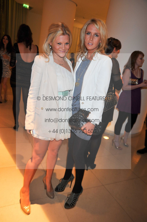 Left to right, OLIVIA 'BUBBLE' PERRY and LUCY HIRST at the St.Martins Lane Hotel 10th year bash held on 9th September 2009.