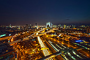Israel, Tel Aviv, Long exposure Night shot of Ayalon highway looking north with Azrieli Center in the bacground centre