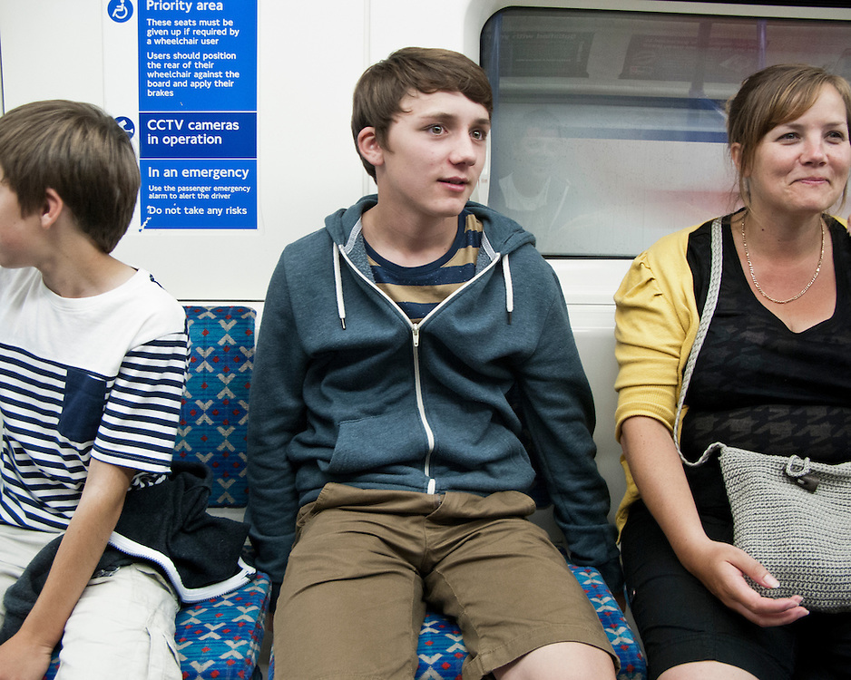 Family travelling on the London Underground