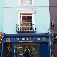 Antique shops and colourful facades in Portobello Road, London