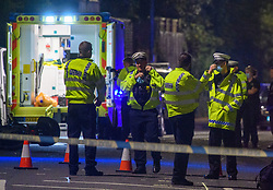 © Licensed to London News Pictures. 06/09/2021. High Wycombe, UK. Police at the scene in High Wycombe following a fatal road traffic collision involving a car and a motorbike. Emergency services, including an air ambulance, were called to the scene at approximately 20:15BST to the corner of London Road (A40) and Hammersley Lane. The motorcyclist died at the scene. A large section of London Road between Station Road and Gomm Road was closed for several hours as police conducted an investigation into the collision. Photo credit: Peter Manning/LNP