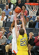 CHARLOTTESVILLE, VA- NOVEMBER 29: Mike Scott #23 of the Virginia Cavaliers shoots the in front of Evan Smotrycz #23 of the Michigan Wolverines during the game on November 29, 2011 at the John Paul Jones Arena in Charlottesville, Virginia. Virginia defeated Michigan 70-58. (Photo by Andrew Shurtleff/Getty Images) *** Local Caption *** Mike Scott;Evan Smotrycz