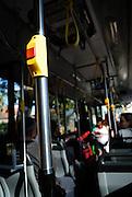 """Stop"" button and interior of public transport bus. Sydney, Australia.."