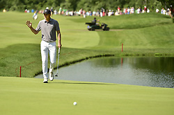 June 21, 2018 - Cromwell, CT, USA - Jordan Spieth acknowledges the gallery around the 13th hole after coming up short on his eagle putt during the first round of the Travelers Championship on Thursday, June 21, 2018 at TPC River Highlands in Cromwell, Conn. Spieth made par and is tied with Zach Johnson for the lead at 7 under par. (Credit Image: © John Woike/TNS via ZUMA Wire)