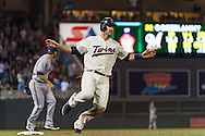 Joe Mauer #7 of the Minnesota Twins rounds 3rd base during a game against the Milwaukee Brewers on May 29, 2013 at Target Field in Minneapolis, Minnesota.  The Twins defeated the Brewers 4 to 1.  Photo: Ben Krause