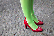 Red shoes and green tights. The Art Car Boot Fair in a car park just off Brick Lane in East London. This is an alternative art event where artists show their works and engage with the public. The Art Car Boot Fair was an idea that grew out of a desire to re-introduce some summer fun and frivolity into a thriving but increasingly commercial London art scene. The aim for the Art Car Boot Fair is to be a day when the artists let their hair down and for all-comers to engage with art in a totally informal way, and to pick up some real art bargains.