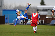 Bristol Rovers player Michael Smith (l) battles for the ball with Gillingham's Adam Birchall (17).  NPower league two match, Bristol Rovers v Gillingham at the Memorial stadium in Bristol on Saturday 5th Jan 2013. pic by Andrew Orchard, Andrew Orchard sports photography,