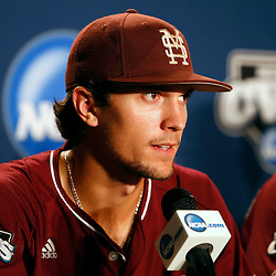 Jun 25, 2013; Omaha, NE, USA; Mississippi State Bulldogs shortstop Adam Frazier (12) addresses the media in a press conference after game 2 of the College World Series finals against the UCLA Bruins at TD Ameritrade Park. UCLA defeated Mississippi State 8-0. Mandatory Credit: Derick E. Hingle-USA TODAY Sports