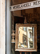 Street scene reflected in mirrow, Rome, Italy