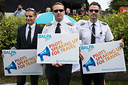 Representatives of the British Airline Pilots Association BALPA pose outside the Houses of Parliament during a day of action intended to apply pressure on the government to reopen the travel sector and to give financial support to travel businesses on 23rd June 2021 in London, United Kingdom. Pilots, cabin crew and travel agents accused the government of failing to restart travel by undermining its Covid-19 traffic light system, which currently does not include viable major tourist destinations on the quarantine-free green list.