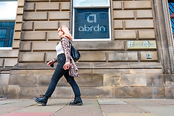 Edinburgh, Scotland, UK. 17th August  2021. Member of public walks past the rebranded abrdn offices on George Street in Edinburgh.  Iain Masterton/Alamy Live news.