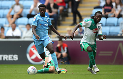 Coventry City's Jordy Hiwula (left) is fouled and awarded a penalty after a challenge by Plymouth Argyle's Graham Carey (centre) alongside Plymouth Argyle's Tafari Moore
