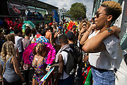 Monday on 28th August 2016 at Notting Hill Carnival in West London. A celebration of West Indian / Caribbean culture and Europes largest street party, festival and parade. Revellers come in their hundreds of thousands to have fun, dance, drink and let go in the brilliant atmosphere. It is led by members of the West Indian / Caribbean community, particularly the Trinidadian and Tobagonian British population, many of whom have lived in the area since the 1950s. The carnival has attracted up to 2 million people in the past and centres around a parade of floats, dancers and sound systems.