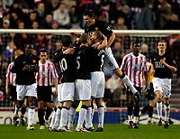 Photo: Jed Wee/Sportsbeat Images.<br /> Sunderland v Manchester United. The FA Barclays Premiership. 26/12/2007.<br /> <br /> Manchester United's Michael Carrick (16) jumps on his team mates as they congratulate Cristiano Ronaldo.