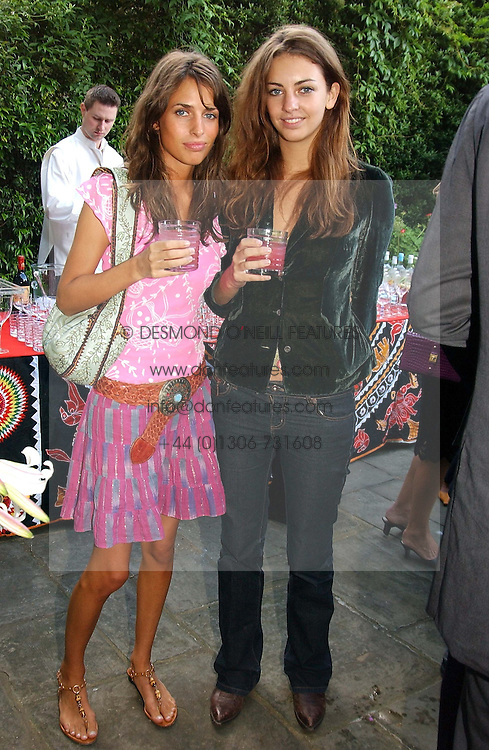 Left to right, sisters MISS MARINA HANBURY and MISS ROSE HANBURY at a Conservative Party summer garden party hosted by Lord Hesketh and held at 7 Lansdowne Road, Notting Hill, London W11 on 28th June 2004.