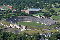Yale Bowl in the Foreground. Shown behind the Bowl is Coxe Cage indoor Track and Field Facility at Yale University, New Haven, CT. Auld Design for Petersen Aluminum. 24 July 2014. Photography by Helicopter.