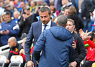 Watford Head coach and Manager Slavisa Jokanovic with Brighton Manager Chris Hughton during the Sky Bet Championship match between Brighton and Hove Albion and Watford at the American Express Community Stadium, Brighton and Hove, England on 25 April 2015. Photo by Phil Duncan.