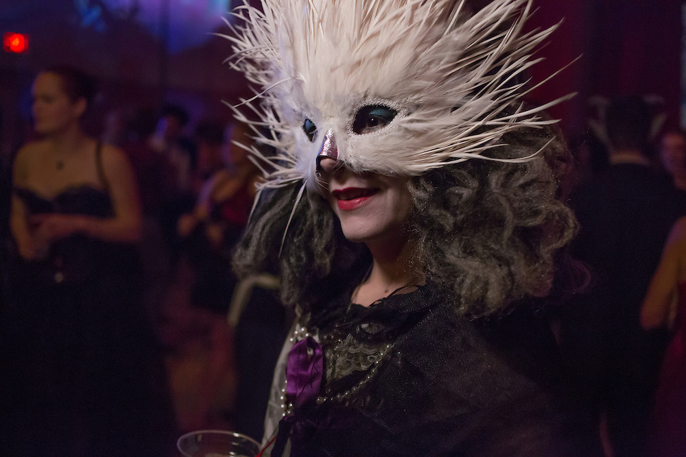 A woman with an elaborate mask.