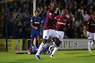West Ham United defender Angelo Ogbonna (21) celebrating after scoring goal to make it 1-2 during the EFL Carabao Cup 2nd round match between AFC Wimbledon and West Ham United at the Cherry Red Records Stadium, Kingston, England on 28 August 2018.
