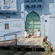 Rajasthani man sitting in the streets of Jodhpur, known as the Blue City.