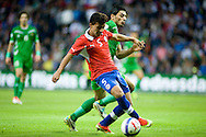 14.09.13. Brondby, Denmark.Bryan Rabello (C) of Chile is chased by Saif Salman Almohammedawi of Irak during friendly match at the Brondby Stadium in Denmark.Photo: © Ricardo Ramirez