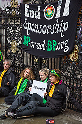 London, UK. 10 June, 2019. Artists and activists from BP or not BP? disrupt the BP Portrait Award with a 'creative blockade' against oil sponsorship. The activists linked arms to block all entrances to the National Portrait Gallery, forcing guests to the awards to clamber over railings at the rear entrance to gain access, as well as creating live portraits outside the gallery of activists from West Papua, Mexico, Samoa and the US Gulf Coast fighting back against BP's pollution and climate devastation around the world. Energy company BP has sponsored the NPG's award for 30 years, but its high-profile involvement is attracting growing criticism for environmental reasons. A judge of this year's award, leading artist Gary Hume, has publicly called for the gallery to end its relationship with BP, as have eight former exhibitors including two former award winners Wim Heldens and Craig Wiley. Credit: Mark Kerrison/BP or not BP?
