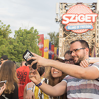 Revellers take a selfie at the entrance of Sziget Festival held in Budapest, Hungary on Aug. 7, 2019. ATTILA VOLGYI