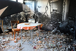 © Licensed to London News Pictures .An interior view of 'Paris 13 Tower'. Also known as 'Tour Paris 13', this derelict apartment block in Paris has been transformed into a housing project and a giant blank canvas for over 100 international street artists. 'Paris 13 Tower' is spread over nine floors and covers over 4,500 square meters of ground space in 36 apartments. The building is only open to the public in October and it is set to be demolished in November. (29/10/2013) . Photo credit : Isabel Infantes /LNP