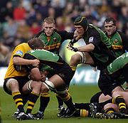 Northampton, Northamptonshire, 2nd October 2004 Northampton Saints vs London Wasps, Zurich Premiership Rugby, Franklyn Gardens, [Mandatory Credit: Peter Spurrier/Intersport Images],<br /> Wasps Jonny O'Connor, tackles Saints Andrew Blowers as Selbourne Boome [cap] charges through to support. Darren Fox [left] and Tom Smith [right]