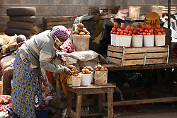 May 11, 2020, Nairobi, Kenya: A woman sells food items in Eastleigh area during the protest..Eastleigh Residents took to the street to protest restriction of movement in the area due to the widespread case of Covid-19 within the residential area and appealed to the government to provide them with relief food. Kenya has confirmed 672 cases of Covid-19 and 32 deaths. (Credit Image: © Billy Mutai/SOPA Images via ZUMA Wire)