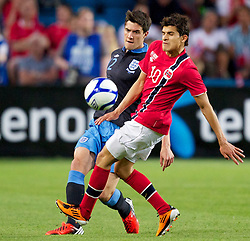 26.05.2012, Ullevaal Stadion, Oslo, NOR, UEFA EURO 2012, Testspiel, Norwegen vs England, im Bild England's Martin Kelly (Liverpool) in action against Norway's Tarik Elyounoussi (Fredrikstad) during the Preparation Game for the UEFA Euro 2012 betweeen Norway and England at the Ullevaal Stadium, Oslo, Norway on 2012/05/26. EXPA Pictures © 2012, PhotoCredit: EXPA/ Propagandaphoto/ Vegard Grott..***** ATTENTION - OUT OF ENG, GBR, UK *****