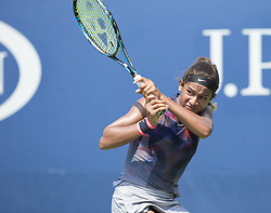 August 22, 2017 - New York, New York, United States - Whitney Osuigwe of USA returns ball during qualifying game against Anna Blinkova of Russia at US Open 2017 (Credit Image: © Lev Radin/Pacific Press via ZUMA Wire)