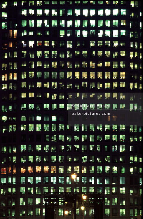 Office lights illuminate the 800 foot tower at 1 Canada Square, Canary Wharf in London Docklands, one of the tallest buildings in Europe.  Designed by the Argentine architect César Pelli, construction was completed in 1991. Identifiable from a great distance as an obelisk-shaped tower with its aircraft warning light flashing on top, this building is a monument to 1980s-style capitalism...From the 'Windows' series. ..Since Microsoft brought about the name Windows to brand the PC computing user interface, I have taken it upon myself to collect and henceforth, add to - a group of pictures about the original window, long after the original word was hijacked by a man called Gates.  More will be added during 2007...Windows have been around for a long time - the Romans invaders even had a glass substance that sealed the chilly British air - and stench - from their sensitive Roman noses. ..Nowadays, I'm attracted to the labelling and messaging that becomes attached to the inside or outside of panes of glass, as if they are urban, public post-it notes for anything an individual wishes to share or advertise.  Sometimes the message can be a warning, a cry for help or just an accidental freak of mis-spelling that somehow creates a different meaning altogether to that intended. ..