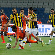 Fenerbahce's Mehmet Topal 2ndL) and Mehmet Topuz (2ndR) during their Turkish Super League soccer match Istanbul Basaksehir between Fenerbahce at the Basaksehir Fatih Terim Arena at Basaksehir in Istanbul Turkey on Monday, 25 May 2015. Photo by Aykut AKICI/TURKPIX